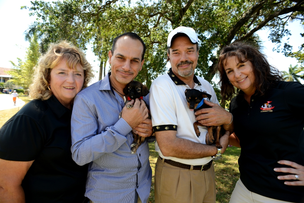 Cheri Marshall, Event Organizer, Actor Said Faraj, Emerging Magazine Editor, Stefan du Bois, and Event Organizer Melody Saleh show love to animals from Humane Society shelter