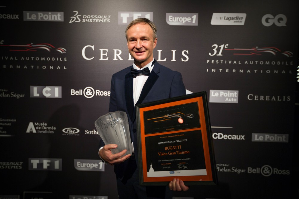 "In Paris, Achim Anscheidt, Bugatti Design Director, accepts the ""Grand Prix de la Créativité"" for the Vision Gran Turismo"