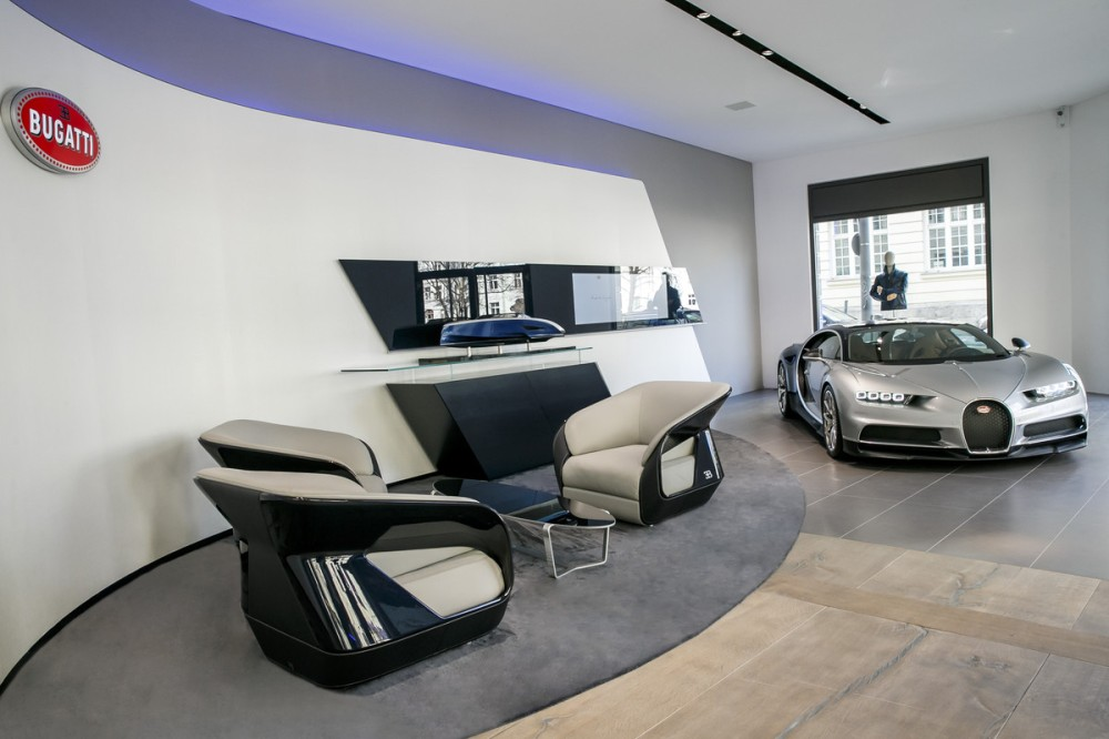 Blue, Bugatti's brand colour, predominates the modern presentation of the vehicle showroom.